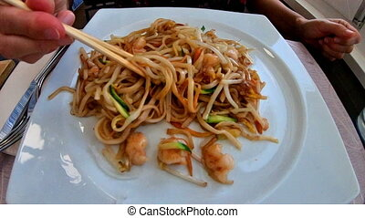 Chinese shrimps spaghetti - SLOW MOTION: chopsticks picking...
