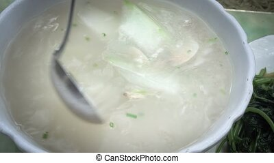 Chinese soup dish with mussels in China restaurant