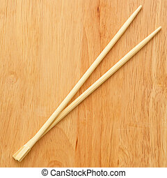 Chinese sticks on a wooden board