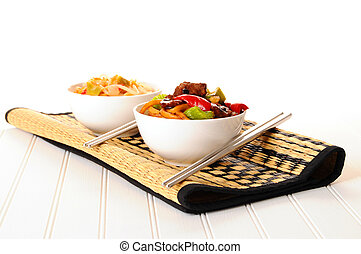 Chinese Stirfry - Bowls of delicious chinese food on a...