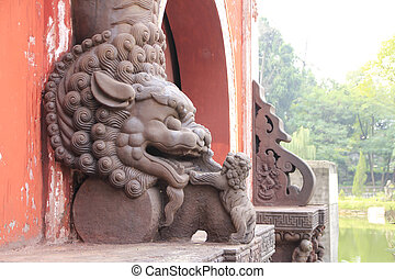 Chinese stone lion at the entrance of Guangde temple