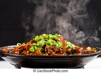 chinese style steaming stew meat with spring onion garnish