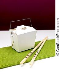 Chinese Takeaway - Chop sticks and a takeaway box on a...
