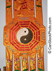 Chinese Taoist sign design on yellow silk, closeup of photo
