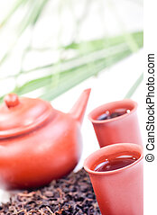 Chinese tea in clay cup close up
