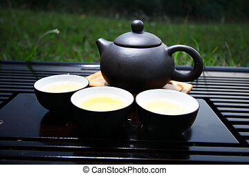 Chinese tea set on grasses