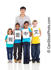 chinese teacher standing with group of students