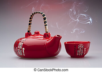 Chinese teapot with steaming cup