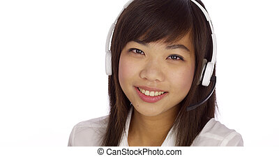 Chinese telemarketer looking at camera