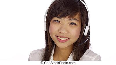 Chinese telemarketer looking at camera