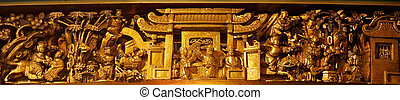 Chinese traditional wood golden carving of panorama.