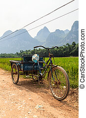 Chinese transportation in a Li river mountain landscape, ...