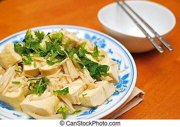 Chinese vegetarian bean curd cuisine. Ingredients include bean curd and mushrooms. Suitable for food and beverage, healthy eating and lifestyle, and diet and nutrition.