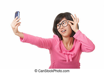 Chinese Woman - A beautiful Chinese woman using a cell phone...