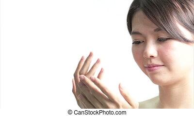 Chinese Woman Applying Cream