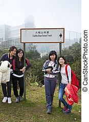 Chinese woman friends hiking