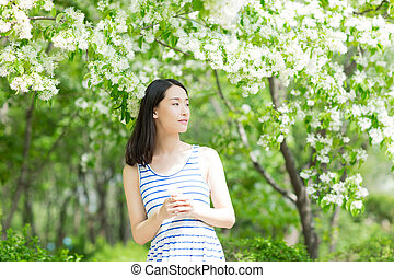 chinese Woman In a Park