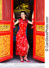 Chinese woman in red dress traditional, Cheongsam.