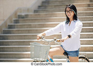Chinese woman sitting on bicycle