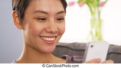 Chinese woman using webcam on smartphone