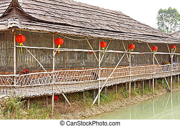 chinese wood house near water