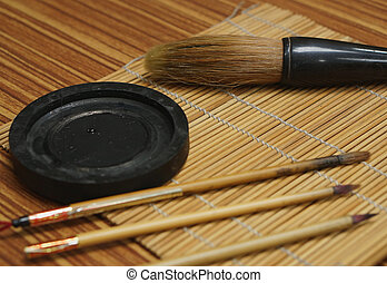 Chinese writing brush and ink stone on Keep brush mat.