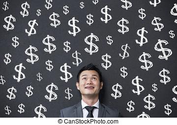 chinesisches , geschäftsmann, vor, dollarzeichen, geschrieben, auf, wall.
