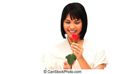 Chiness woman holding a red rose