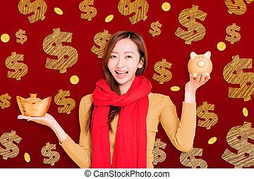 chinois, femme asiatique, célébrer, projection, banque, or, nouveau, year., porcin, jeune