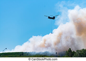 chinook helicopter extinguishes a large fire - HENGELO,...