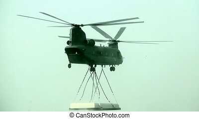 Chinook helocopter transpoted a concreet roof.