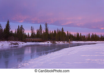 Chinook Sunrise - The colours of sunrise are reflected in a...