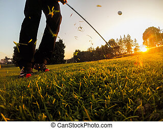 Golf: example of short game using a wedge iron club.