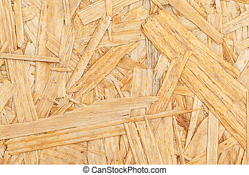 Chipboard. Close up pressed wooden panel background, OSB wood