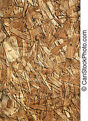 pattern of construction grade pressboard made of glued wood chips, for a background