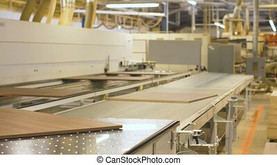 chipboards on conveyer at furniture factory - production,...