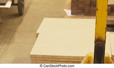 chipboards on loader at furniture factory storage -...