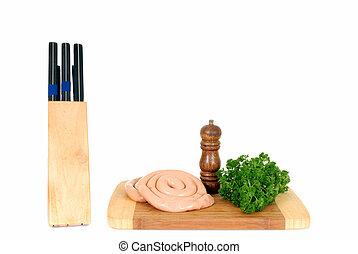 chipolata on cutting board