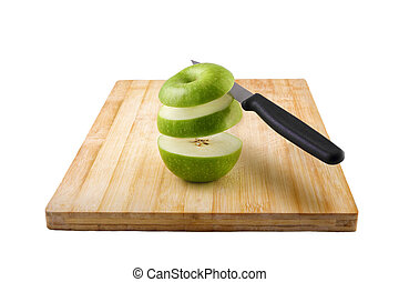 chipped apple on a cutting board with a knife