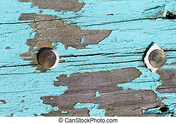 Chipped Paint - Closeup view of blue paint chipped away on a...