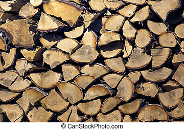 chipped wood ready for heating in the fireplace