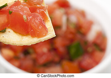 Chips and Fresh salsa in a bowl against a white background