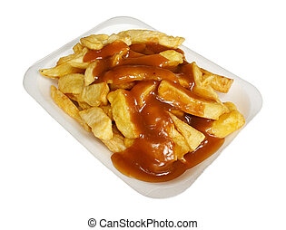 French Fries or Chips and gravy a popular european takeaway snack, served in a polystyrene tray from a take out.