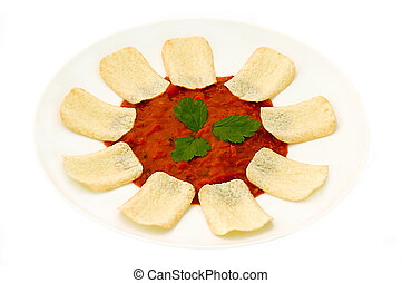 Chips and Salsa dip with coriander leaf garnish.