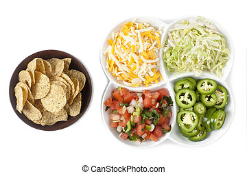 chips and toppings - Bowl of nacho chips and a set of ...
