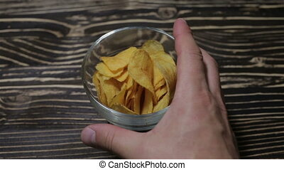 Chips are in a glass vase on the table - Chips in a glass...