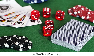 Chips, deck of cards and dice on table