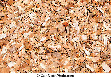 Chips of orange cypress mulch for background use