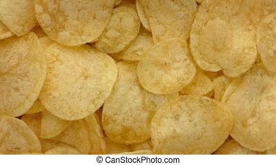 Chips Rotating - Bowl of potato chips turning slowly