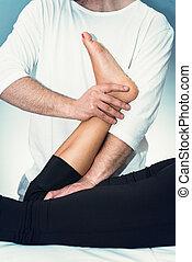 Chiropractic adjustment - Chiropractor working with...